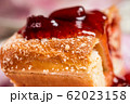 Strudel with strawberry jam and a cup of tea 62023158