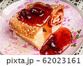 Strudel with strawberry jam and a cup of tea 62023161