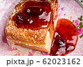 Strudel with strawberry jam and a cup of tea 62023162