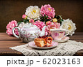 Strudel with strawberry jam and a cup of tea 62023163