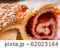 Strudel with strawberry jam and a cup of tea 62023164