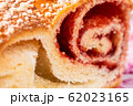 Strudel with strawberry jam and a cup of tea 62023165