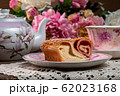 Strudel with strawberry jam and a cup of tea 62023168