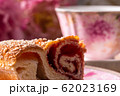 Strudel with strawberry jam and a cup of tea 62023169