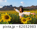 woman enjoying with sunflower field at Kao Jeen 62032983