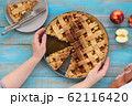 Home-baked lattice apple pie, in a baking dish. 62116420