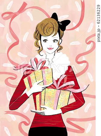 リボンの背景にプレゼントを持った女性 62136229