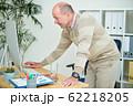 Businessman working in office 62218205