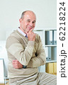 Smiling middle-aged businessman 62218224