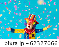 Funny kid clown playing indoor 62327066