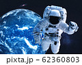 Astronaut near night Earth planet in outer space 62360803