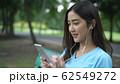 Holiday concept. Asian girl is enjoying listening 62549272