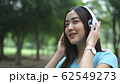 Holiday concept. Asian girl is enjoying listening 62549273