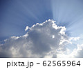 Powerful rays of sunlight through many clouds 62565964