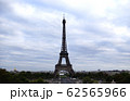 Large view of Eiffel Tower in Paris with a Cloudy Sky 62565966