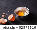 Raw eggs in a bowl and egg shell 62575516