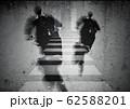 成功への階段をかけ上がるビジネスマンの後ろ姿 62588201