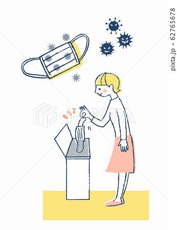 使用済みマスクをゴミ箱に入れる女性 62765678