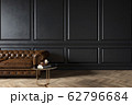 Modern classic black interior with capitone chester leather brown sofa, coffee table, wood floor, mouldings. 62796684