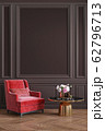 Classic brown chocolate, colorful, interior with red, coral armchair, coffee table, flowers and wall moldings. 62796713