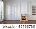 Classic white empty interior with fireplace, moldings, wall pannel, window, door. 62796735