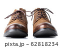 Pair of brown leather womens boots on the white 62818234