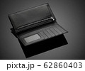 men's wallet on a black background 62860403