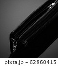 men's wallet on a black background 62860415