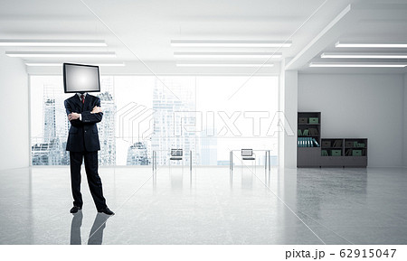 Businessman with TV instead of head. 62915047