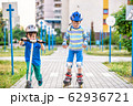 Two kid boy on roller skates and his sibling 62936721