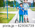 Two kid boy on roller skates and his sibling 62936739