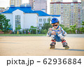 Little boy riding on rollers in the summer in the 62936884