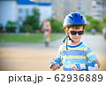 Little boy riding on rollers in the summer in the 62936889