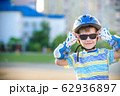 Little boy riding on rollers in the summer in the 62936897