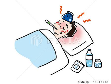 発熱し寝込む一人暮らしの男性が体温計をくわえている 63013538