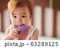 Baby biting purple toy 63289125