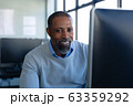 African American man in office looking at camera 63359292