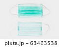 Typical three-ply surgical masks, medical masks, procedure mask, or simply as a face mask on white background. 63463538