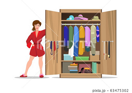 Woman with open closet 63475302