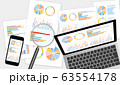 グラフ資料をモニターに表示したノートパソコン・スマホ・虫眼鏡セットグレー背景 63554178