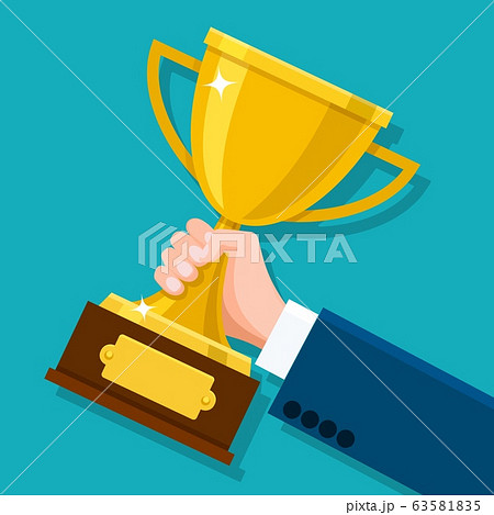Business hand holding trophy 63581835