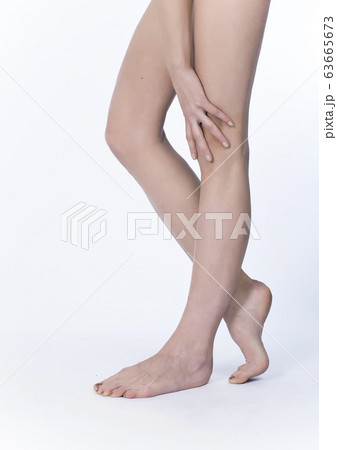 Beautiful legs and hand on a white background 63665673