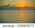 sunset and siluet of fisherman very far away 63665675