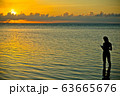 siluet of romantic girl reading a book during sunset 63665676