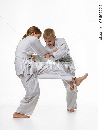 Two judo students try to hook each other up 63667227