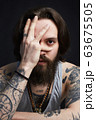 portrait of handsome man with beard and tattoo 63675505