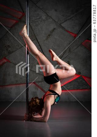Beautiful girl dancing on the pole at studio 63778817