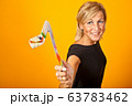 Scandinavian woman with boomerangs 63783462
