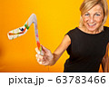 Scandinavian woman with boomerangs 63783466