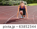 Scandinavian woman at outdoor fitness 63852344